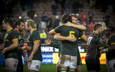Respective captains and long-time friends Victor Matfield and Bakkies Botha embrace after the Springboks beat the World XV at Newlands on 11 July 2015. Picture: Aletta Gardner/EWN