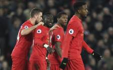 Liverpool players celebrate a goal. Picture: AFP