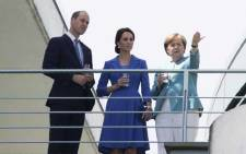 Britain's Prince William and his wife Kate are seen on the terrace of the Chancellery in Berlin on 19 July 2017 during a meeting with German Chancellor Angela Merkel. Picture: AFP