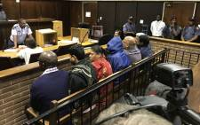 The suspects in the Vrede dairy farm project case appear in the Bloemfontein magistrates court on 15 February 2018. Picture: Barry Bateman/EWN