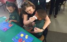 FILE: Western Cape Education MEC Debbie Schäfer consoles a pupil on the first day of school on 11 January 2017. Picture: @jessicashelver