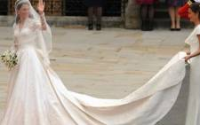 Kate Middleton (L) waves as she arrives with her sister, the Maid of Honour Philippa Middleton at the West Door of Westminster Abbey. Picture: AFP