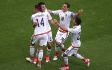 Mexico's forward Hirving Lozano (2nd L) celebrates a second goal during the 2017 Confederations Cup group A football match between Mexico and Russia at the Kazan Arena Stadium in Kazan on June 24, 2017. Picture: AFP.