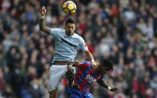 FILE: West Ham United's Portuguese defender Jose Fonte (L) vies with Crystal Palace's Ivorian striker Wilfried Zaha during the English Premier League football match between Crystal Palace and West Ham United at Selhurst Park in south London on 28 October 2017. Picture: AFP.
