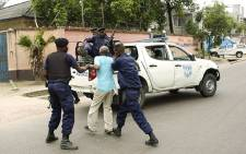 DRC police arrest a protester. Picture: AFP