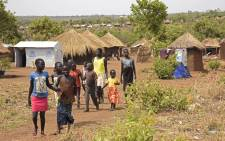 FILE: Refugee children from South Sudan walk in Bidibidi resettlement camp. Picture: AFP