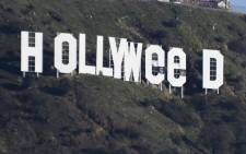 The famous Hollywood sign reads 'Hollyweed' after it was vandalised on 1 January 2017. Picture: AFP.
