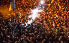 Riot police clash with pro-EU protestors on Independence Square in Kiev on 11 December 2013. Picture: AFP.