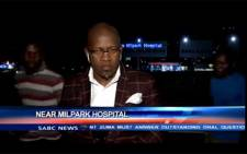 A screengrab shows SABC contributing editor, Vuyo Mvoko, being mugged outside Milpark Hospital in Johannesburg during live recording.