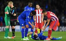 Leicester City striker Leonardo Ulloa (C) and Atletico Madrid defender Jose Maria Gimenez (R) help a dejected Leicester City's striker Jamie Vardy up following the UEFA Champions League quarterfinal tie between the two sides. Picture: AFP