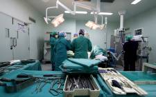 Doctors during surgery. Picture: EWN