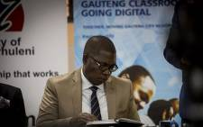 Gauteng Education MEC Panyaza Lesufi reads through his notes during a technical briefing ahead of the top provincial achievers announcement in Daveyton on 5 January 2017. Picture: Reinart Toerien/EWN
