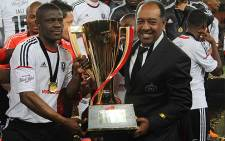 Orlando Pirates captain Lucky Lekgwathi and coach Augusto Palacios with the Carling Black Label Cup. Picture: Taurai Maduna/EWN