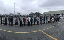 Commuters queue for taxis in Mitchells Plain on day one of the bus drivers strike on 18 April 2018. Picture: Cindy Archillies/EWN
