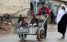 Displaced Iraqis flee their homes in an area west of Mosul on 14 April 2017, during the ongoing offensive to retake the city from Islamic State (IS) group jihadists. Picture: AFP