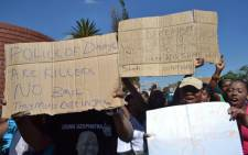 Community members protest outside the Benoni Magistrate Court on 4 March, where eight police officers appeared for the death of Daveyton Taxi Driver Mido Macia.