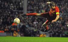 Liverpool's English midfielder Steven Gerrard shoots during the second leg of the UEFA Europa League round of 32 football match between Liverpool and Zenit St. Petersburg on February 21, 2013. Picture: AFP PHOTO/ANDREW YATES