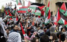 Protestors wave the Palestinian flag during a demonstration outside the US embassy in Awkar, on the outskirts of the Lebanese capital Beirut, on December 10, 2017, to protest against Washington's decision to recognise Jerusalem as the capital of Israel. Picture: AFP
