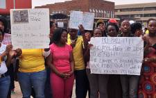 Daveyton residents protested outside the Benoni Magistrate's Court on 12 March 2013, against the release of the nine policemen being accused of killing taxi driver Mido Macia. Picture: Govan Whittles/EWN
