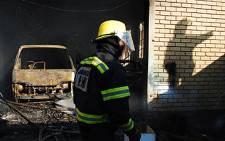 Firemen put out a fire. Picture: Taurai Maduna/Eyewitness News