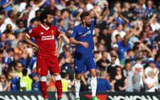 Chelsea's Olivier Giroud, seen next to Liverpool's Mohamed Salah, celebrate scoring a goal a Stamford Bridge. Picture: @ChelseaFC/Twitter.