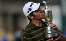 Sweet victory: Louis Oosthuizen celebrates his British Open win on 18 July 2010. Picture: AFP