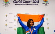 India's Heena Sidhu waves from the podium at the awards ceremony following her victory in the women's 25m pistol shooting during the 2018 Gold Coast Commonwealth Games at the Belmont Shooting Complex in Brisbane on 10 April 2018. Picture: AFP