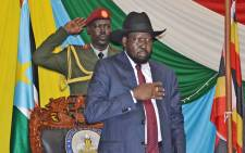 South Sudans President Salva Kiir stands for South Sudans national anthem before signing a peace agreement in the capital Juba, on 26 August, 2015. Picture: AFP.