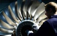 A Rolls-Royce engineer works on an engine. Picture: @RollsRoyce/Twitter
