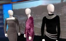 A screengrab from CNN's YouTube channel shows three dresses that belonged to late singer Whitney Houston. Picture: YouTube