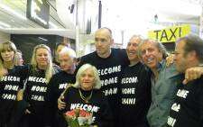 Shani Krebs posing for a picture with his family and friends at O R Tambo