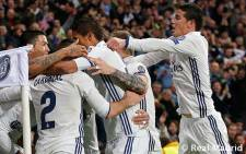 FILE: Real Madrid players embrace Cristiano Ronaldo after he scored a goal. Picture: realmadrid.com