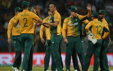 South Africa's Kyle Abbott (C) is congratulated by teammates after taking the wicket of England's Alex Hales during the World T20 cricket tournament match between England and South Africa at The Wankhede Stadium in Mumbai on March 18, 2016. Picture: AFP/Indranil Mukherjee