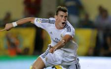 Real Madrid's Gareth Bale celebrates after scoring during the Spanish league match against Villarreal CF on 14 September 14 2013. Picture: AFP