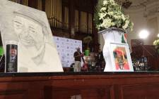 Portraits on stage at the Johannesburg City Hall  where a provincial government memorial service was held for activist and poet Keorapetse Kgositsile, on 11 January 2018. Picture: Thando Kubheka/EWN.