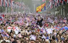 Royal supporters wave British Union Jack flags during the royal wedding in central London on April 29, 2011. Picture: AFP