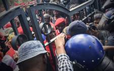 EFF Leader Julius Malema negotiates with officers to allow marchers through the gates of the Union Buildings on 2 November 2016. Picture: Thomas Holder/EWN