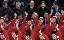 North Korean cheerleaders performs before (Top L-R) South Korea's president Moon Jae-in, president of the International Olympic Committee Thomas Bach, President of the Presidium of the Supreme People's Assembly of North Korea Kim Yong Nam, Kim Yo Jong of North Korea, and president of the Pyeongchang Organising Committee Lee Hee-Beom watch the women's on 10 February 2018. Picture: AFP.