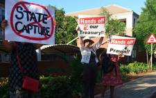 A group of about 60 people has picketed outside the Sars headquarters in Pretoria to show their support for Finance Minister Pravin Gordhan. Picture: Barry Bateman/EWN.