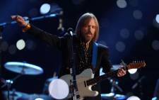 This file photo taken on 2 February 2008 shows musician Tom Petty performing during halftime at Super Bowl XLII at the University of Phoenix Stadium in Glendale, Arizona. Picture: AFP.