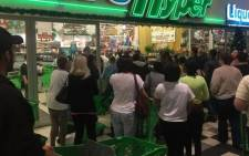FILE: Shoppers queue outside a Checkers Hyper for Black Friday specials. Picture: @CheckersSA via Twitter.