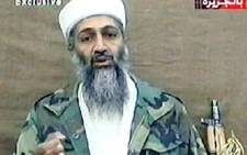 A television frame grab taken 03/11/2001 from a videotape broadcast by Al-Jazeera satellite TV, shows terror suspect Saudi born Osama bin Laden. Picture: AFP