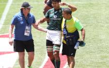South Africa's Chris Dry is helped off the field after injuring his knee in Cape Town. Picture: @Blitzboks/Twitter