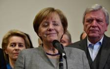 German Chancellor and leader of the Christian Democratic Union party, Angela Merkel, closes her eyes while speaking after exploratory talks on forming a new government broke down on 19 November 2017 in Berlin. Picture: AFP.