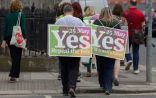 "Activists from the ""Yes"" campaign, urging people to vote 'yes' in the referendum to repeal the eighth amendment of the Irish constitution, canvas voters in Dublin on 24 May, 2018. Picture: AFP"