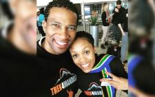 Renowned South African racing driver Gugu Zulu and his wife Letshego posing for a photo at the O.R. Tambo International Airport in Johannesburg on 13 July 2016 ahead of their trip to Tanzania. Picture: Facebook.