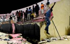 People look at the scene after a wall collapsed at Demba Diop stadium 15 July 2017 in Dakar after a football game between local teams Ouakam and Stade de Mbour. Picture: AFP