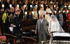 The Prince of Wales accompanied Ms Meghan Markle down the aisle of the Quire of St George's Chapel. Picture: @ClarenceHouse/Twitter.