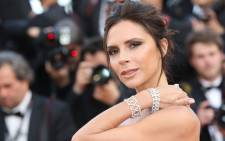 British fashion designer Victoria Beckham poses as she arrives on 11 May 2016 for the opening ceremony of the 69th Cannes Film Festival in Cannes, southern France. Picture: AFP.