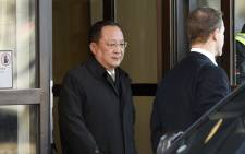 FILE: North Korean Foreign Minister Ri Yong Ho (L) leaves the Swedish government building Rosenbad in central Stockholm on 16 March 2018. Picture: AFP.